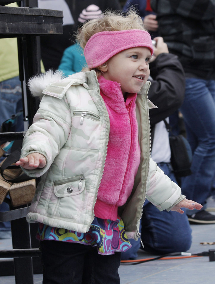 "Allie Zimmerman, 3, sings along. Singer Gayla Peevey came back to Oklahoma City at the Zoo to sing her hit song from 1953, ""I Want a Hippopotamus for Christmas"" Sunday, November 20, 2011. Photo by Doug Hoke, The Oklahoman"
