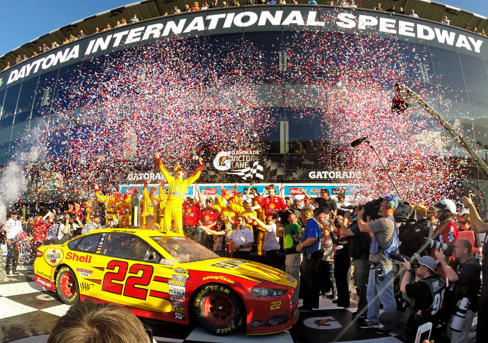 Photo - Joey Logano celebrates in Victory Lane after winning the Daytona 500 NASCAR Sprint Cup series auto race at Daytona International Speedway, Sunday, Feb. 22, 2015, in Daytona Beach, Fla. (AP Photo/Orlando Sentinel, Joe Burbank) MAGS OUT; NO SALES