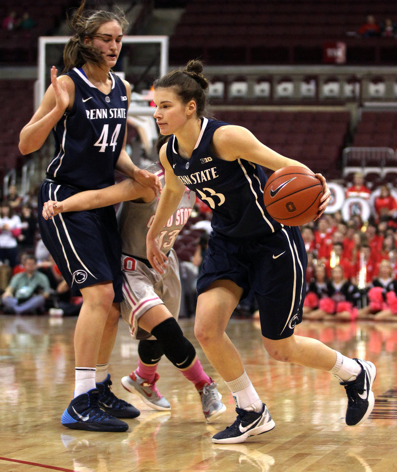 Photo - Penn State's Maggie Lucas (33) drives against Ohio State during the second half of an NCAA women's college basketball game, Sunday, Feb. 9, 2014, in Columbus, Ohio. Penn State won 74-54. (AP Photo/Mike Munden)