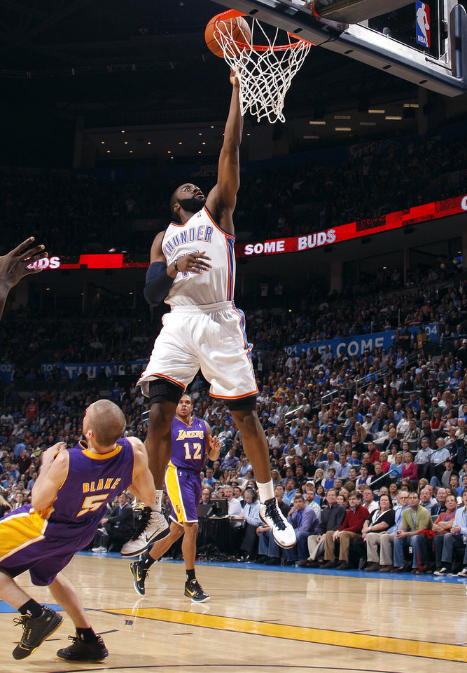 Photo - Oklahoma City's James Harden (13) shoots as Lakers' Steve Blake (5)  defends during the NBA basketball game between the Oklahoma City Thunder and the Los Angeles Lakers, Sunday, Feb. 27, 2011, at the Oklahoma City Arena.Photo by Sarah Phipps, The Oklahoman