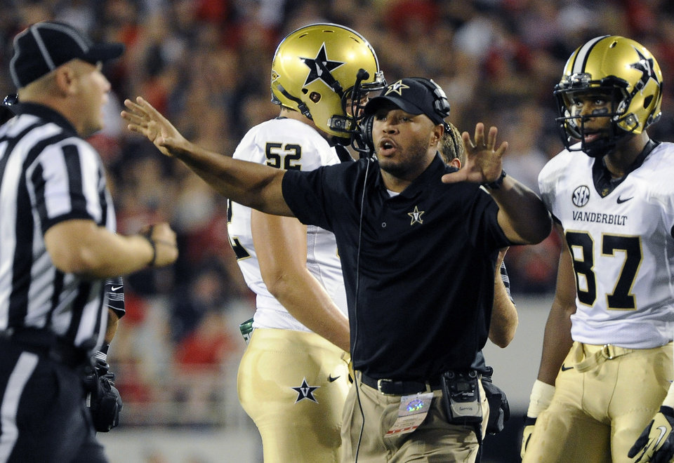 Photo -   Vanderbilt head coach James Franklin, second from right, shouts to a referee during the first quarter of an NCAA college football game against Georgia, Saturday, Sept. 22, 2012, in Athens, Ga. (AP photo/John Amis)