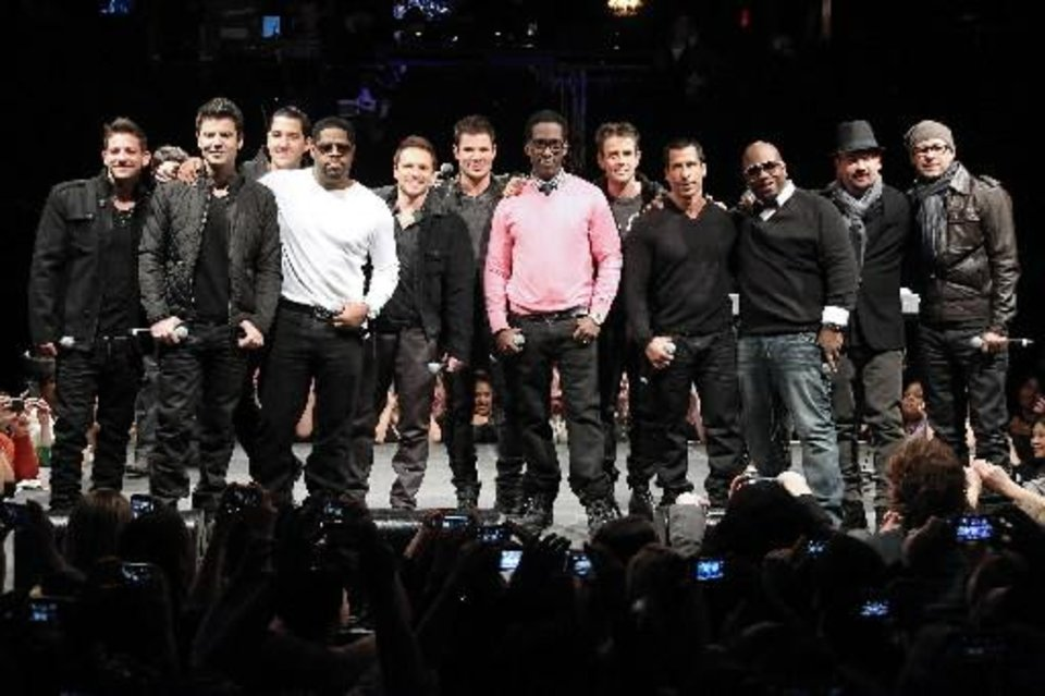 "This picture provided by Starpix shows members of 98 Degrees, Boyz II Men, and New Kids on the Block, during the announcement of ""The Package Tour,"" Tuesday, Jan. 22, 2013 in New York. The major summer tour will feature the three bands. (AP)"