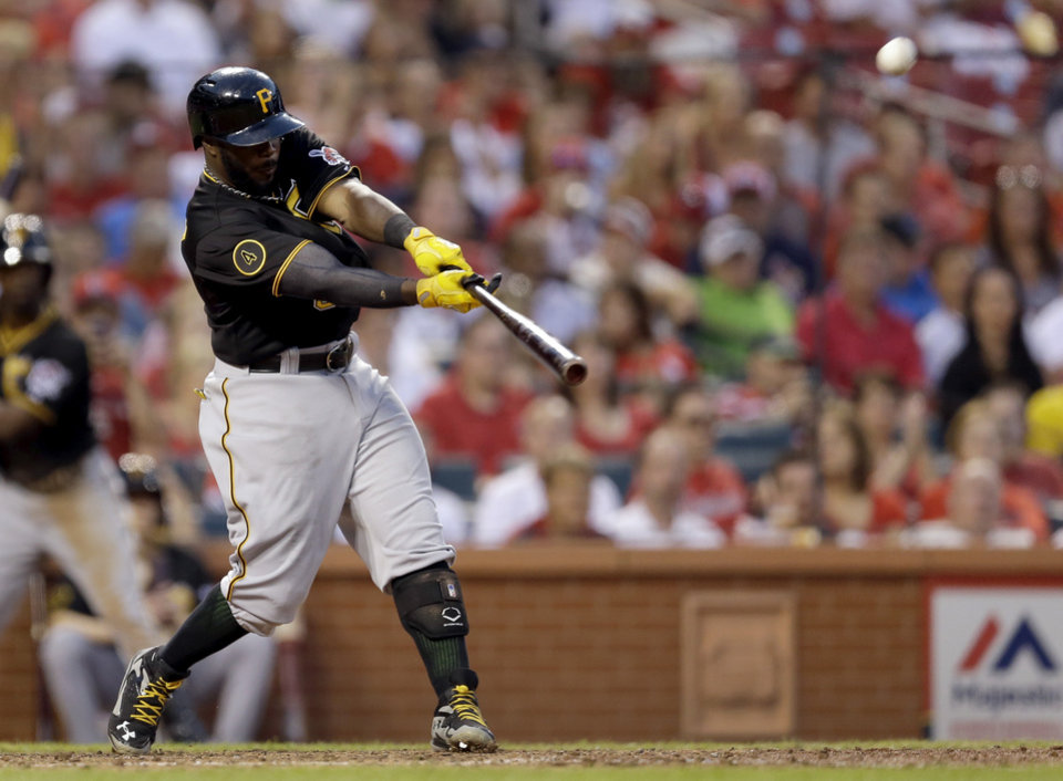 Photo - Pittsburgh Pirates' Josh Harrison hits a ground-rule double to score Edinson Volquez and Pedro Alvarez during the sixth inning of a baseball game against the St. Louis Cardinals Thursday, July 10, 2014, in St. Louis. (AP Photo/Jeff Roberson)