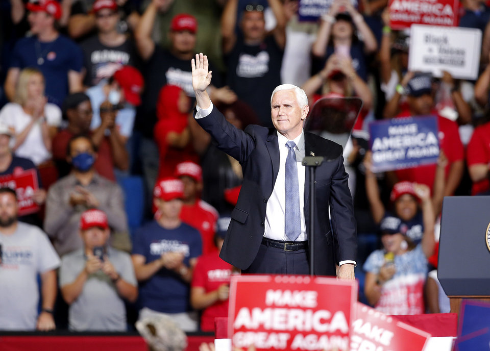 Photo - Vice President Mike Pence waves after speaking during the President Donald Trump rally at the BOK Center in Tulsa, Okla., Saturday, June 20, 2020. [Sarah Phipps/The Oklahoman]