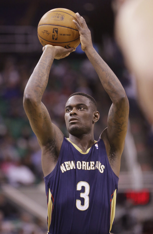 Photo - New Orleans Pelicans' Anthony Morrow shoots a free throw in the second quarter during an NBA basketball game against the Utah Jazz on Friday, April 4, 2014, in Salt Lake City. The Jazz won 100-96.  (AP Photo/Rick Bowmer)
