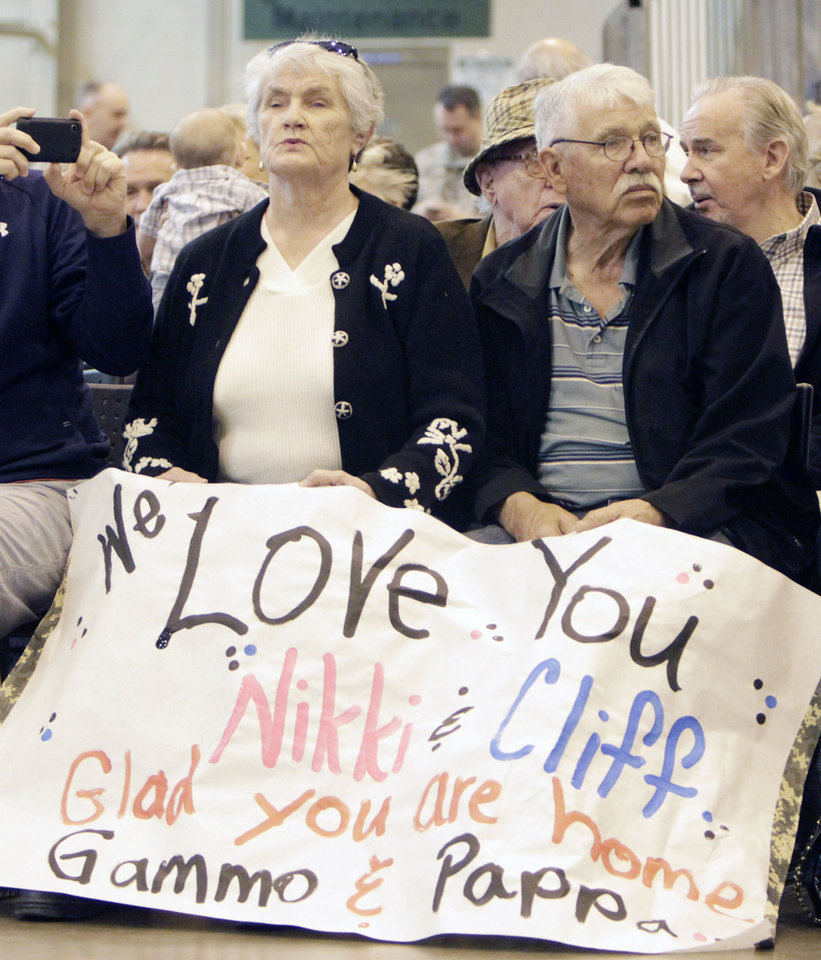 Andy and Glenna Wilkerson wait to greet two of their returning relatives, as Oklahoma National Guard soldiers return from Afghanistan to a welcome home ceremony in Oklahoma City, OK, Tuesday, March 13, 2012, By Paul Hellstern, The Oklahoman
