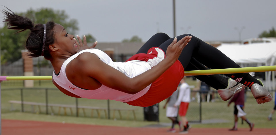 Photo - Carl Albert's Camille Burge competes in the Class 5A girls high jump during the Class 6A and 5A state championship track meet at Yukon High School on Saturday, May 17, 2014 in Yukon, Okla.   Photo by Chris Landsberger, The Oklahoman