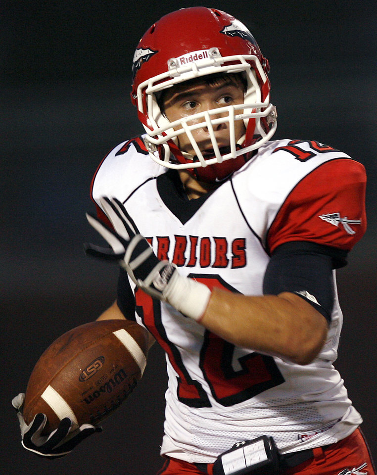 Photo - Washington's Robert Rhynes takes the ball downfield during their high school football game against Bethany in Bethany, Okla., on Friday, September 16, 2011. Photo by John Clanton, The Oklahoman