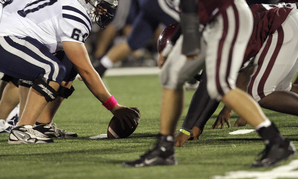 Photo - Edmond North's Berkley Reed wears a pink wristband for Win-Win Week during the high school football game between Edmond North and Edmond Memorial at Wantland Stadium in Edmond, Okla., Friday, Sept. 16, 2011. Photo by Sarah Phipps, The Oklahoman