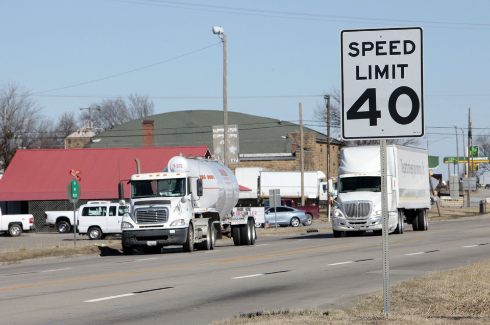 Photo - Tractor-trailers roll past a speed sign on U.S. 69 in Kiowa. Photo by David McDaniel, The Oklahoman  David McDaniel