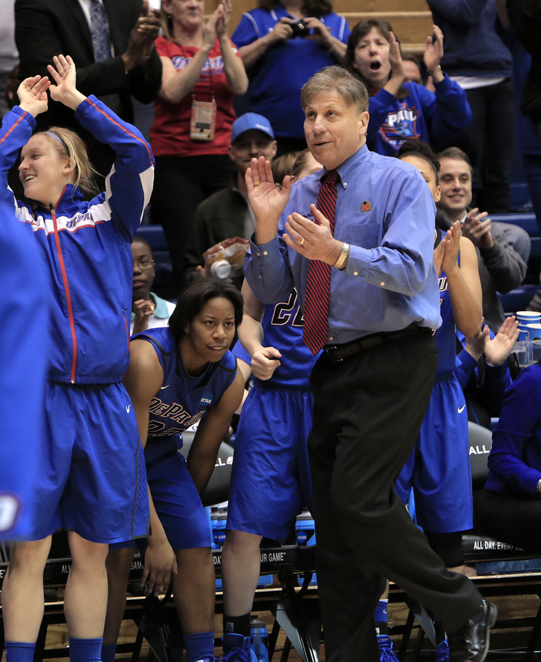 Photo - DePaul head women's basketball coach Doug Bruno watches his team pull further ahead during the second half of Duke's 74-65 loss in their second-round game in the NCAA basketball tournament in Durham, N.C., Monday, March 24, 2014.  (AP Photo/Ted Richardson)