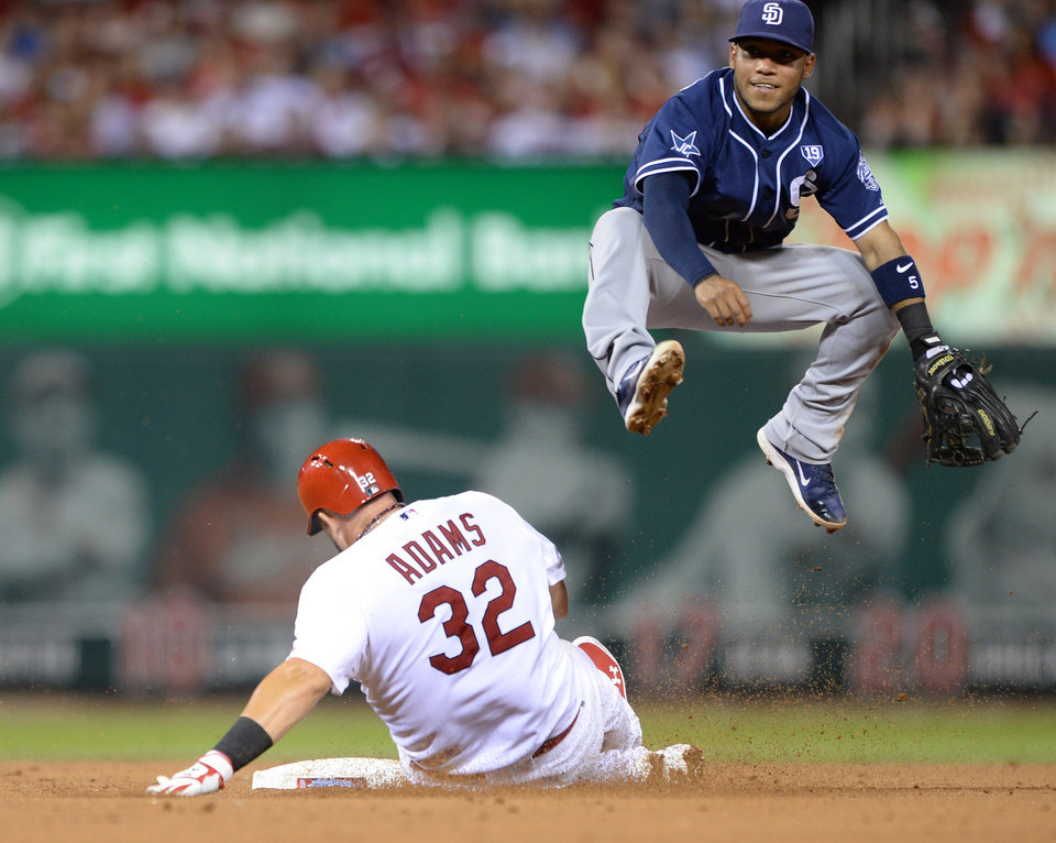 Photo - St. Louis Cardinals' Matt Adams (32) is forced out at second by San Diego Padres' Alexi Amarista, right, who completed the double play to get Cardinals' Jhonny Peralta at first in the fourth inning in a baseball game, Thursday, Aug. 14, 2014, at Busch Stadium in St. Louis. (AP Photo/Bill Boyce)