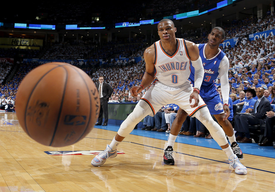 Photo - Oklahoma City's Russell Westbrook (0) and Los Angeles' Chris Paul (3) watch a loose ball go out of bounds during Game 2 of the Western Conference semifinals in the NBA playoffs between the Oklahoma City Thunder and the Los Angeles Clippers at Chesapeake Energy Arena in Oklahoma City, Wednesday, May 7, 2014. Photo by Bryan Terry, The Oklahoman