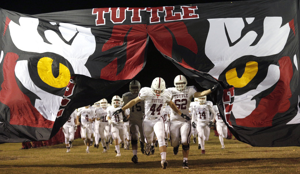 Tuttle runs on to the filed before the high school football game between Blanchard and Tuttle in Blanchard,Okla.,  Friday, Nov. 8, 2013. Photo by Sarah Phipps, The Oklahoman
