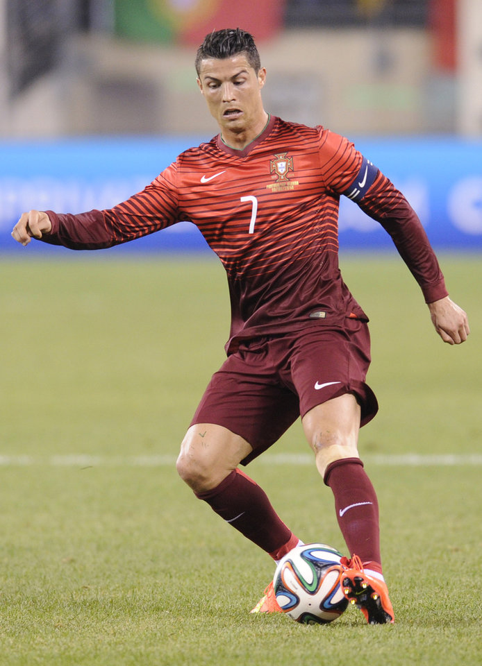 Photo - Portugal's Cristiano Ronaldo controls the ball during the second half of an international friendly soccer match against the Republic of Ireland Tuesday, June 10, 2014, in East Rutherford, N.J. Portugal won 5-1. (AP Photo/Bill Kostroun)