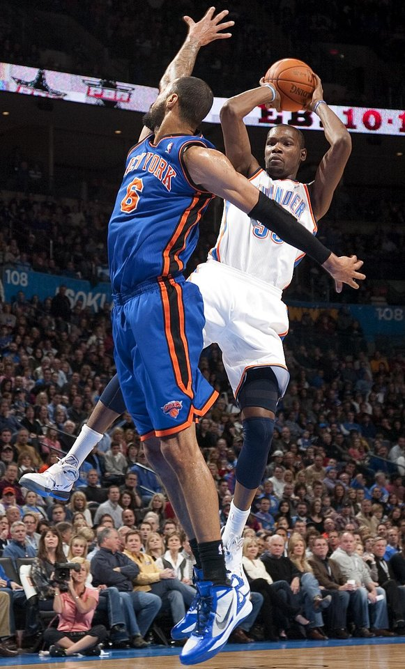 Oklahoma City's Kevin Durant (35) passes the ball around New York's Tyson Chandler (6) during the NBA game between the Oklahoma City Thunder and the New York Knicks at Chesapeake Energy Arena in Oklahoma CIty, Saturday, Jan. 14, 2012. Photo by Bryan Terry, The Oklahoman