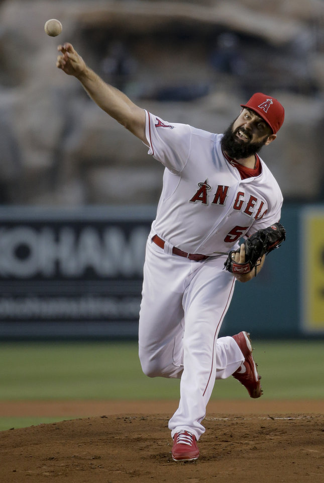 Photo - Los Angeles Angels starting pitcher Matt Shoemaker throws against the Miami Marlins during the first inning of a baseball game in Anaheim, Calif., Tuesday, Aug. 26, 2014. (AP Photo/Chris Carlson)