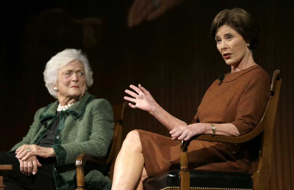 Former first lady Laura Bush, right, speaks as former first lady Barbara Bush listens during the Enduring Legacies of America�s First Ladies conference Thursday, Nov. 15, 2012, in Austin, Texas. Family members, former staff members, historians, and White House insiders also spoke as part of the program. (AP Photo/David J. Phillip)