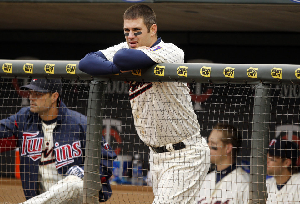 Minnesota Twins designated hitter Joe Mauer watches as the final batter strikes out against New York Mets relief pitcher Bobby Parnell during the ninth inning of a baseball game Saturday, April 13, 2013, in Minneapolis. The Mets won 4-2. (AP Photo/Genevieve Ross)