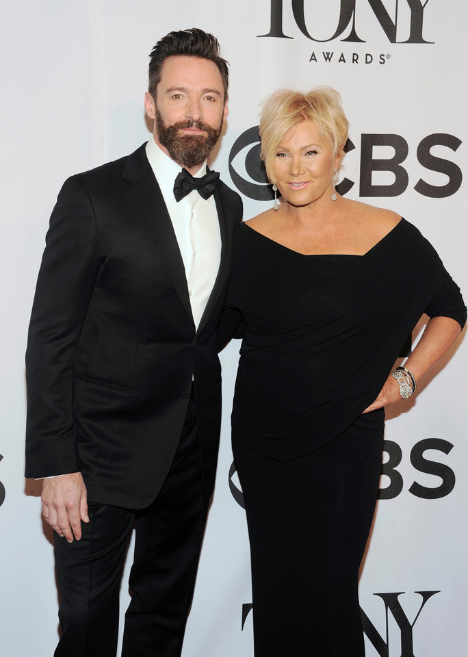 Photo - Hugh Jackman, left, and Deborra-Lee Furness arrive at the 68th annual Tony Awards at Radio City Music Hall on Sunday, June 8, 2014, in New York. (Photo by Charles Sykes/Invision/AP)