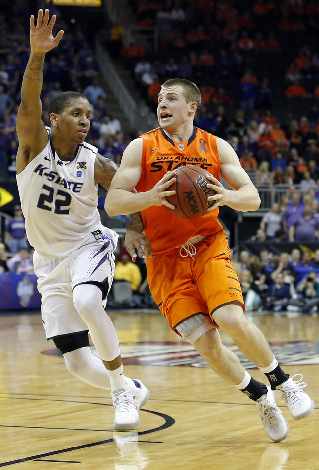Oklahoma State's Phil Forte (13) tries to get past Kansas State's Rodney McGruder (22) during the Phillips 66 Big 12 Men's basketball championship tournament game between Oklahoma State University and Kansas State at the Sprint Center in Kansas City, Friday, March 15, 2013. Photo by Sarah Phipps, The Oklahoman