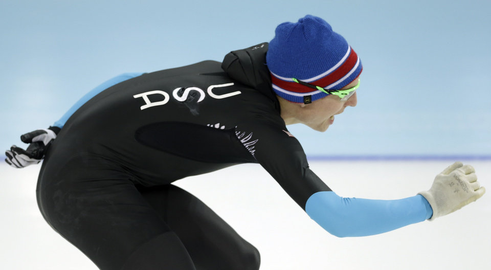 Photo - U.S. Speedskater Jonathan Kuck warms-up wearing the old World Cup race suit, prior to the men's 1,500-meter race at the Adler Arena Skating Center during the 2014 Winter Olympics in Sochi, Russia, Saturday, Feb. 15, 2014. U.S. skaters are looking to bounce back from an awful start to their Olympics by slipping back into their old suits that should have been made obsolete by new high-tech gear. (AP Photo/Patrick Semansky)