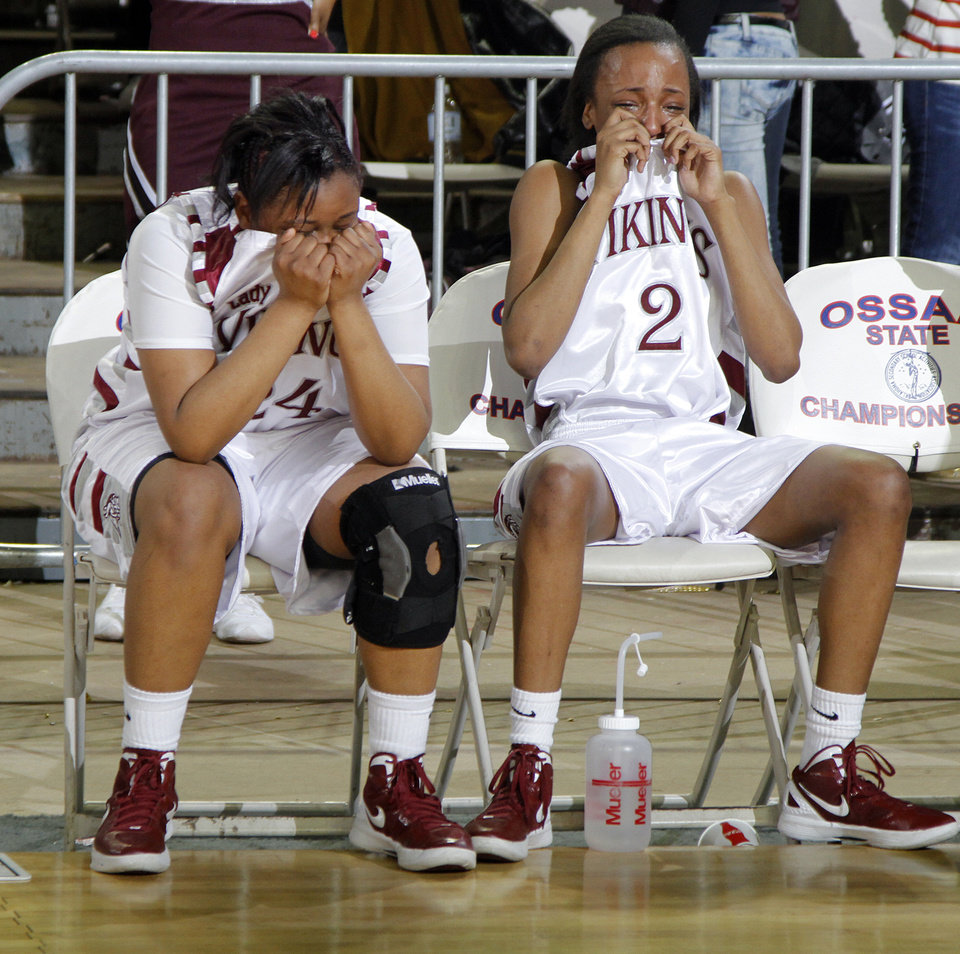 Northeast's Jaelyn Coleman (24) and Morgan Billingsley (2) react after the loss to Fairview during the 2A girls State Basketball Championship game between Northeast High School and Fairview High School at State Fair Arena on Saturday, March 10, 2012 in Oklahoma City, Okla.  Photo by Chris Landsberger, The Oklahoman