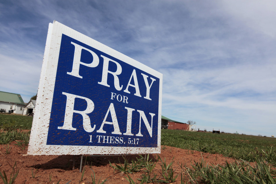 "Photo -  A ""PRAY FOR RAIN"" sign is shown at Elmer, a community near Altus in southwest Oklahoma. The area is in an ongoing battle with exceptional drought conditions, according to the U.S. Drought Monitor. Photo by David McDaniel, The Oklahoman   David McDaniel -"
