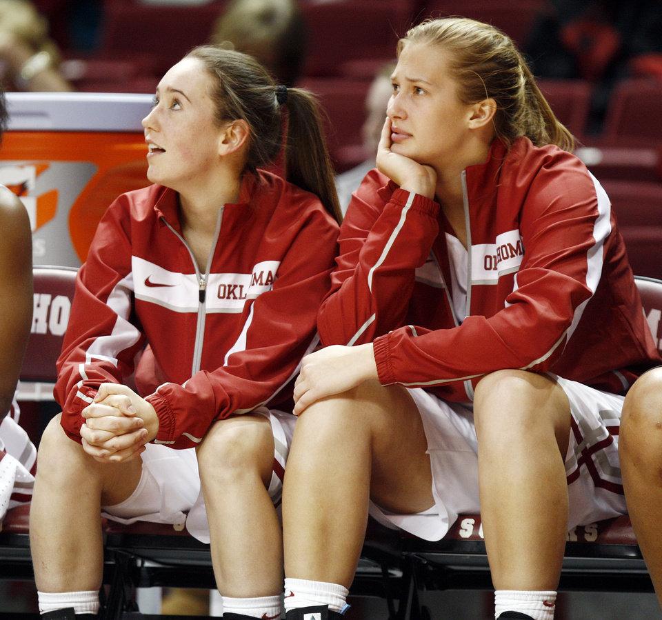 Photo - Oklahoma's Eden Williams (33), left, and Tara Dunn (43) watch from the bench in the second half during a women's college basketball game between the University of Oklahoma (OU) and Cal State Northridge at the Lloyd Noble Center in Norman, Okla., Saturday, Dec. 29, 2012. OU won, 79-57.  Photo by Nate Billings, The Oklahoman