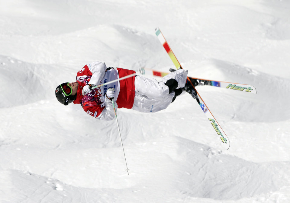 Photo - Canada's Alex Bilodeau jumps during freestyle skiing moguls training at the Rosa Khutor Extreme Park ahead of the 2014 Winter Olympics, Friday, Feb. 7, 2014, in Krasnaya Polyana, Russia. (AP Photo/Andy Wong)