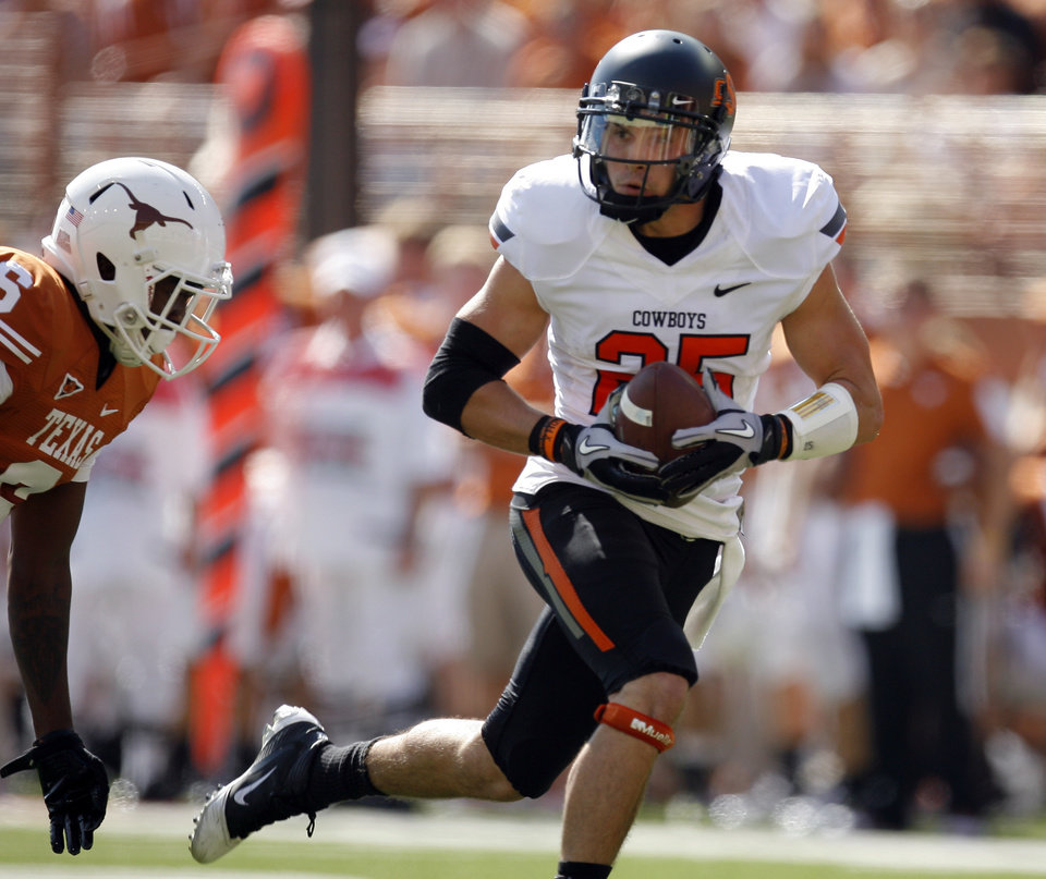 Photo - Oklahoma State's Josh Cooper (25) gets by Texas' Christian Scott (6) during first half of a college football game between the Oklahoma State University Cowboys (OSU) and the University of Texas Longhorns (UT) at Darrell K Royal-Texas Memorial Stadium in Austin, Texas, Saturday, Oct. 15, 2011. Photo by Sarah Phipps, The Oklahoman