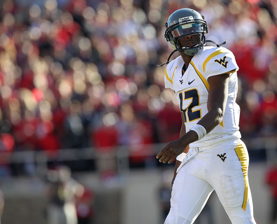 West Virginia's Geno Smith walks off the field against Texas Tech after failing to make a first down during an NCAA college football game in Lubbock, Texas, Saturday, Oct. 13, 2012. (AP Photo/Lubbock Avalanche-Journal, Stephen Spillman) LOCAL TV OUT