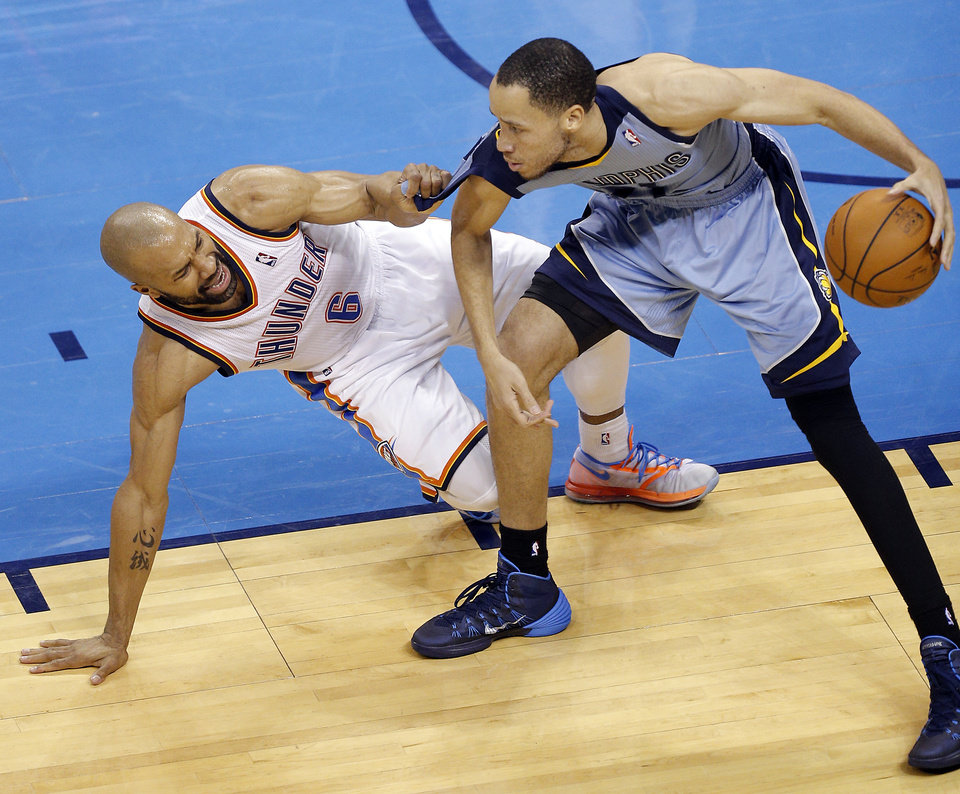 Photo - Oklahoma City's Derek Fisher (6) grabs the jersey of Memphis' Tayshaun Prince (21) as he falls down during Game 7 in the first round of the NBA playoffs between the Oklahoma City Thunder and the Memphis Grizzlies at Chesapeake Energy Arena in Oklahoma City, Saturday, May 3, 2014. Photo by Sarah Phipps, The Oklahoman