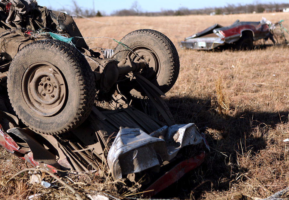 Photo - A man from Jones, Okla., may have died in this truck north of highway 70 following deadly storms around Lone Grove, Okla., Feb. 11, 2009. By John Clanton, The Oklahoman