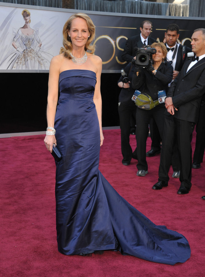 Actress Helen Hunt, wearing a navy blue gown from H&M, arrives at the Oscars at the Dolby Theatre on Sunday Feb. 24, 2013, in Los Angeles. (Photo by John Shearer/Invision/AP) <strong>John Shearer - John Shearer/Invision/AP</strong>