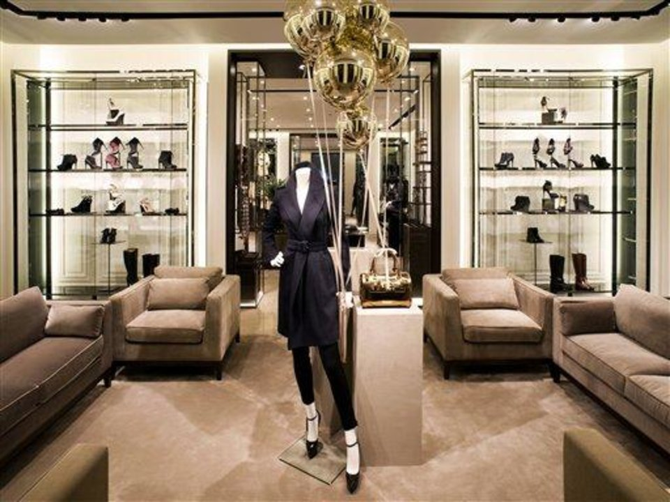 Photo - This undated publicity photo provided by BURBERRY shows shoes in an interior view of the new BURBERRY Flagship store opened in November 2012 on Michigan Avenue in Chicago. BURBERRY is interacting directly with consumers in the digital sphere too, launching projects like artofthetrench.com. The website invites users to upload pictures of themselves wearing BURBERRY trench coats. (AP Photo/BURBERRY)