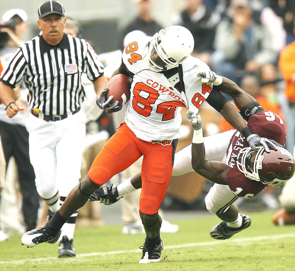Photo - Oklahoma State's Hubert Anyiam fights off Steven Campbell of Texas A&M. Photo by Bryan Terry, The Oklahoman
