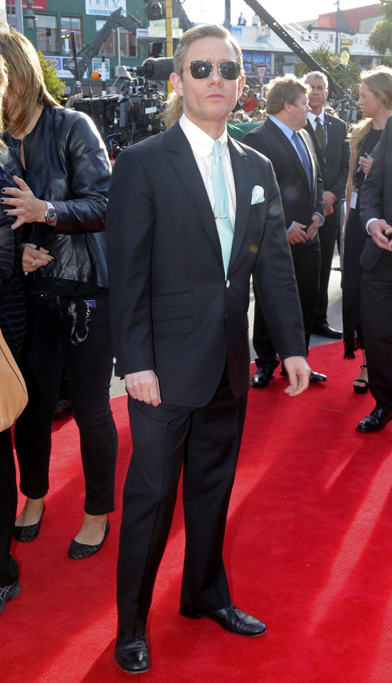 Photo -   Martin Freeman who plays Bilbo Baggins poses on the red carpet for the premiere of