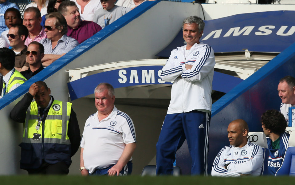 Photo - Chelsea manager Jose Mourinho smiles as he watches their English Premier League soccer match against Norwich City at Stamford Bridge stadium in London, Sunday May 4, 2014. (AP Photo/Alastair Grant)