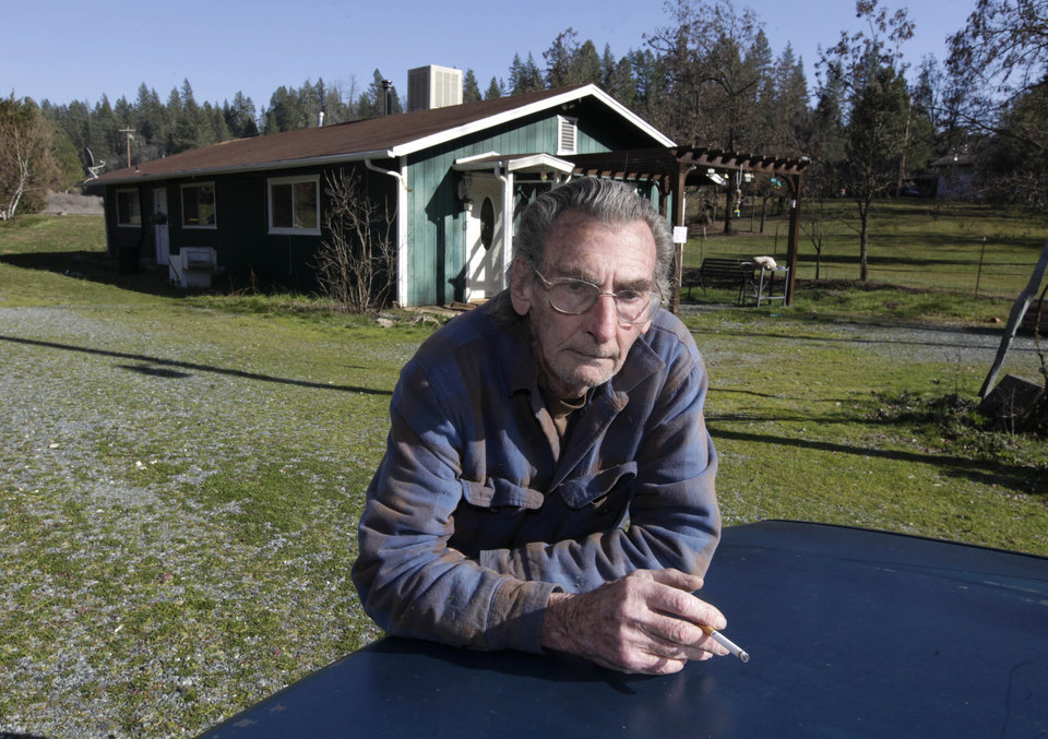 "In this photo taken, Wednesday, Feb. 13, 1013, Vince Cal, who opposes a fire-prevention fee, poses at his home in Greenwood, Calif.   Gov. Jerry Brown is trying to expand a  fire-prevention fee that is unpopular  with many rural property owners.  Cal called the fee  ""just another tax."" (AP Photo/Rich Pedroncelli)"