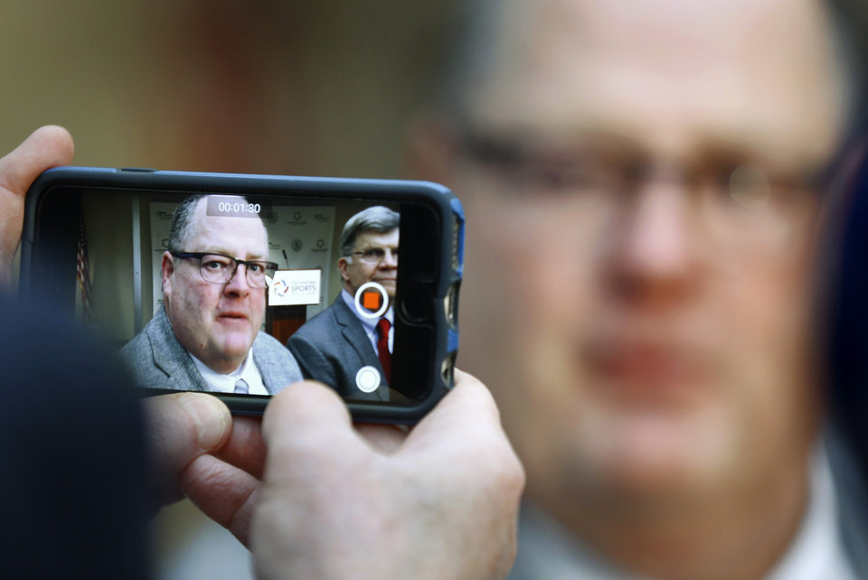 Photo - A reporter uses a cell phone to record a video interview with high school football coach Allan Trimble.  The Class 0f 2018 inductees into the Oklahoma Sports Hal of Fame were introduced at the group's Leadership Luncheon on Monday, Feb. 19, 2018.  Honorees include Joe Castiglione, Larry Coker, Bill Pickett, Allan Trimble, Ken Mendenhall, Mat Hoffman and Robin Ventura. Castiglione, Trimble, Hoffman and Mendenhall attended the luncheon. Photo by Jim Beckel, The Oklahoman
