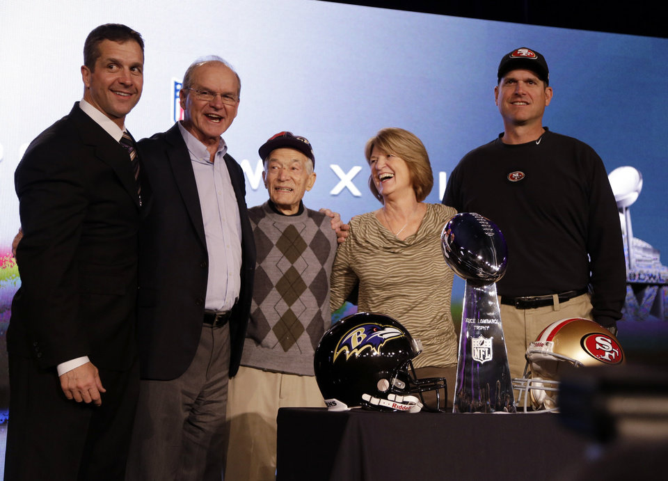 RETRACTS PREVIOUS CORRECTION: THE GRANDFATHER'S NAME IS SPELLED CIPITI, NOT SEPIDI - San Francisco 49ers head coach Jim Harbaugh, right, and Baltimore Ravens head coach John Harbaugh, left, pose with their parents, Jack and Jackie, and grandfather Joe Cipiti during a news conference for the NFL Super Bowl XLVII football game Friday, Feb. 1, 2013, in New Orleans. (AP Photo/Mark Humphrey)