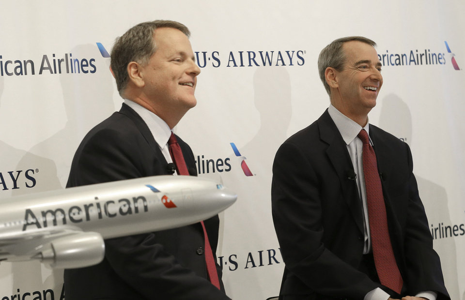 U.S. Airways CEO Doug Parker, left, and American Airlines CEO Tom Horton listen to a question during a news conference at DFW International Airport Thursday, Feb. 14, 2013, in Grapevine, Texas. The two airlines will merge forming the world\'s largest airlines. (AP Photo/LM Otero)