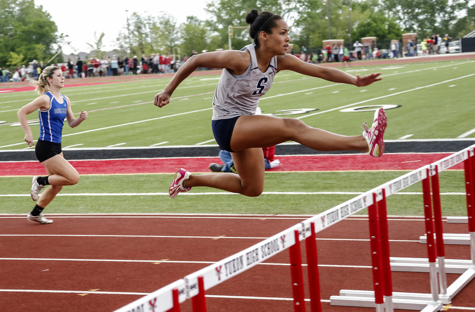 Shawnee's Jasmine Robinson leads the race in the 5A girls 100m hurdles during the class 5A and 6A track state championships at Yukon High School on on Friday, May 10, 2013, in Yukon, Okla.Photo by Chris Landsberger, The Oklahoman
