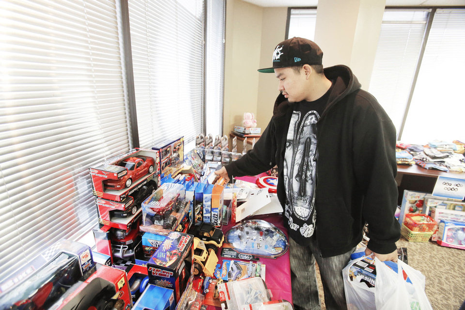Joshua Mitchell selects toys during a toy giveaway at the Oklahoma City Indian Clinic. Photo By Steve Gooch, The Oklahoman <strong>Steve Gooch - The Oklahoman</strong>