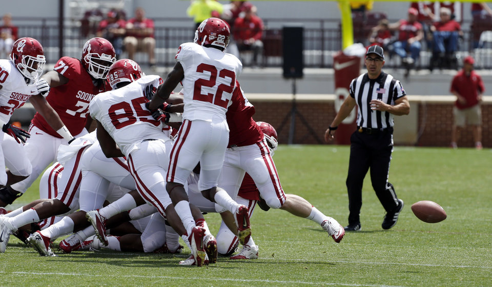 The ball scoots loose and almost unnoticed after a carry by Damien Williams during the annual Spring Football Game at Gaylord Family-Oklahoma Memorial Stadium in Norman, Okla., on Saturday, April 13, 2013. Photo by Steve Sisney, The Oklahoman