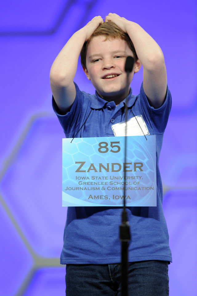 Photo - Zander Reed, 12, of Ames, Iowa, reacts after misspelling his word during the 2015 Scripps National Spelling Bee in Oxon Hill, Md., Wednesday, May 27, 2015. (AP Photo/Cliff Owen)
