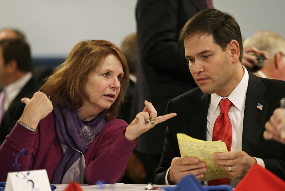 Photo -   Patty Cownie, of Des Moines, Iowa, talks with U.S. Sen. Marco Rubio, R-Fla., during Iowa Gov. Terry Branstad's annual birthday fundraiser, Saturday, Nov. 17, 2012, in Altoona, Iowa. (AP Photo/Charlie Neibergall)