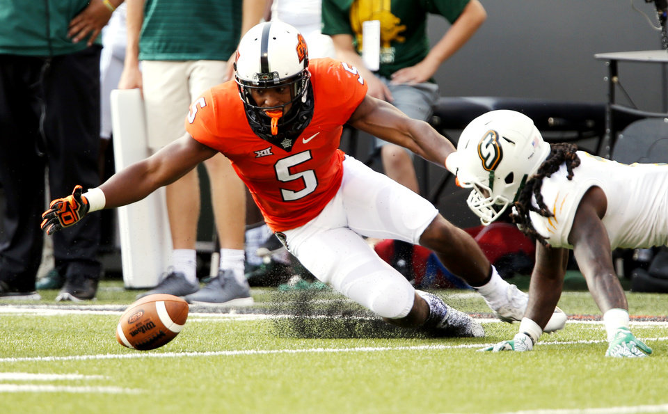 Photo - Oklahoma State's Jerel Morrow (5) recovers an errant pitch in front of Louisiana's Darius Durall (3)