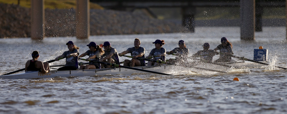 A team from Integris races during the Oklahoma Regatta Festival on the Oklahoma River in Oklahoma City, Thursday, Oct. 3, 2013. Photo by Bryan Terry, The Oklahoman